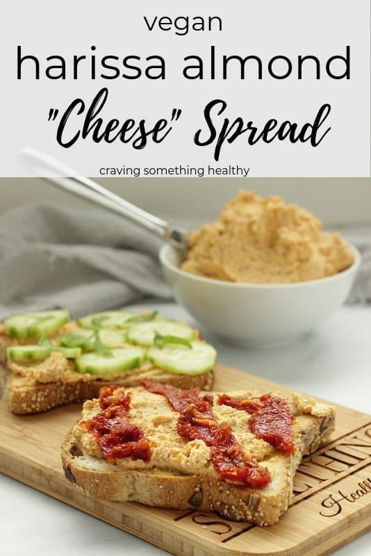 Vegan Harissa Almond Cheese spread on toast and topped with cucumbers and sun-dried tomatoes