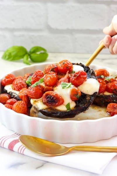 A baking dish with Caprese-stuffed portobello mushrooms