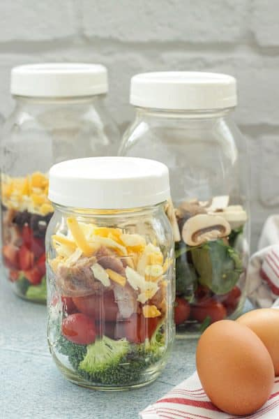 mason jars with chopped vegetables for omelets