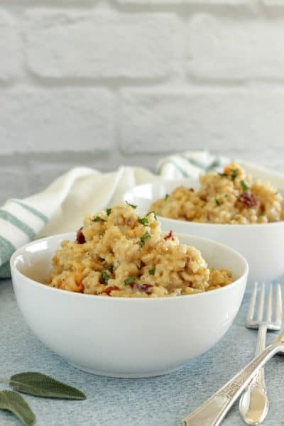 two white bowls of butternut squash brown rice risotto