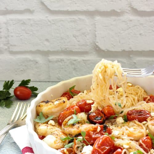 White plate of Shirataki noodles with shrimp and tomatoes